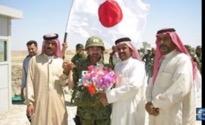 JGSDF Colonel Masahisa Sato (center)